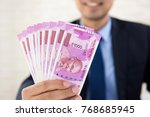 businessman in suit smiling and ...   Shutterstock . vector #768685945