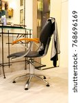 Small photo of salon hairdressing salon a chair for the hairdresser with a cape in front of the mirror