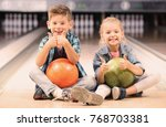 Small photo of Cute little children at bowling club