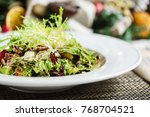 fresh salad on the christmas... | Shutterstock . vector #768704521