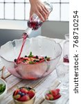 pouring red wine into bowl... | Shutterstock . vector #768710254