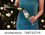 woman pours champagne at new...   Shutterstock . vector #768710719