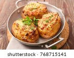 baked stuffed potato  | Shutterstock . vector #768715141