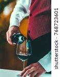 sommelier tasting wine   Shutterstock . vector #768723601