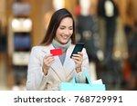 happy shopper holding shopping... | Shutterstock . vector #768729991