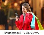 happy shopper wearing a red... | Shutterstock . vector #768729997