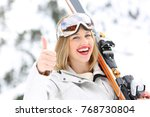 portrait of a happy skier with... | Shutterstock . vector #768730804