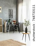 vase on wooden stool and brown... | Shutterstock . vector #768733111