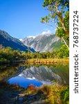 franz josef glacier reflecting...   Shutterstock . vector #768737224