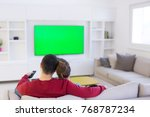 young couple on the sofa... | Shutterstock . vector #768787234