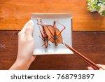 hand holding plate grasshopper... | Shutterstock . vector #768793897