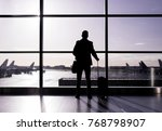 man standing in airport ... | Shutterstock . vector #768798907