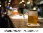 frosty glass of light beer on... | Shutterstock . vector #768806011