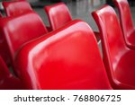 empty red plastic chair in row... | Shutterstock . vector #768806725
