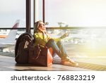 hipster girl waiting for flight ... | Shutterstock . vector #768823219