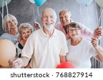 Smiling elderly man and his...