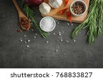 different spices on grey... | Shutterstock . vector #768833827