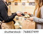 woman paying with card in the... | Shutterstock . vector #768837499