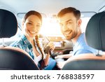 in the car  her family also...   Shutterstock . vector #768838597
