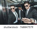 bodyguard stopping paparazzi... | Shutterstock . vector #768847579