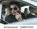 bodyguard in sunglasses talking ... | Shutterstock . vector #768847654