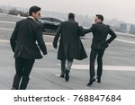rear view of two bodyguards... | Shutterstock . vector #768847684