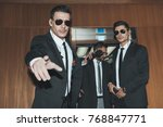 bodyguards stopping paparazzi... | Shutterstock . vector #768847771
