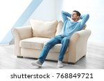 happy young man relaxing at home | Shutterstock . vector #768849721