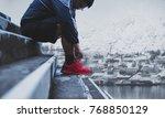 a man tying running shoes ... | Shutterstock . vector #768850129