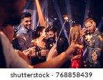 couples dancing in the nightclub   Shutterstock . vector #768858439