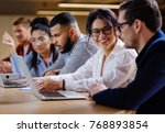 young colleagues discussing... | Shutterstock . vector #768893854