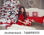 christmas. beautiful brunette... | Shutterstock . vector #768898555