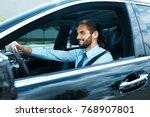 man driving car. portrait of... | Shutterstock . vector #768907801