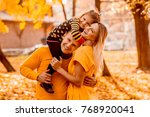 the father and mother embracing ... | Shutterstock . vector #768920041