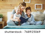 happy family mother reading to  ... | Shutterstock . vector #768925069