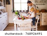 young father with a toddler boy ... | Shutterstock . vector #768926491