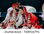 indian bride and groom dressed... | Shutterstock . vector #768926791