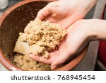 women's hand making rice bran... | Shutterstock . vector #768945454