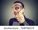 curious business man looking... | Shutterstock . vector #768958219