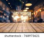 wooden board empty table in... | Shutterstock . vector #768973621