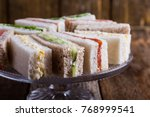 english tea sandwiches on cake... | Shutterstock . vector #768999541