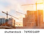 Small photo of Construction of modern altitudinal buildings of concrete and glass early in the morning during sunrise