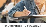 school student's taking exam ... | Shutterstock . vector #769010824