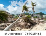 Small photo of Hurricane Irma aftermath destruction to some of st.maarten/stmartin beaches blowing down trees and uprooting some on the beach.