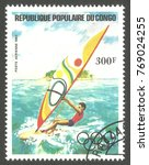 Small photo of Congo - stamp 1984, Memorable multicolor air mail issue of offset printing with Olympic symbols, Olympic Games, Sport, Series Windsurfing