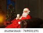 santa claus having a rest in a... | Shutterstock . vector #769031191