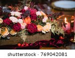 flower arrangement with candles | Shutterstock . vector #769042081