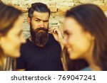 young man hipster brunette with ... | Shutterstock . vector #769047241