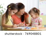 teacher working with creative... | Shutterstock . vector #769048801