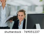 assistant working in office | Shutterstock . vector #769051237